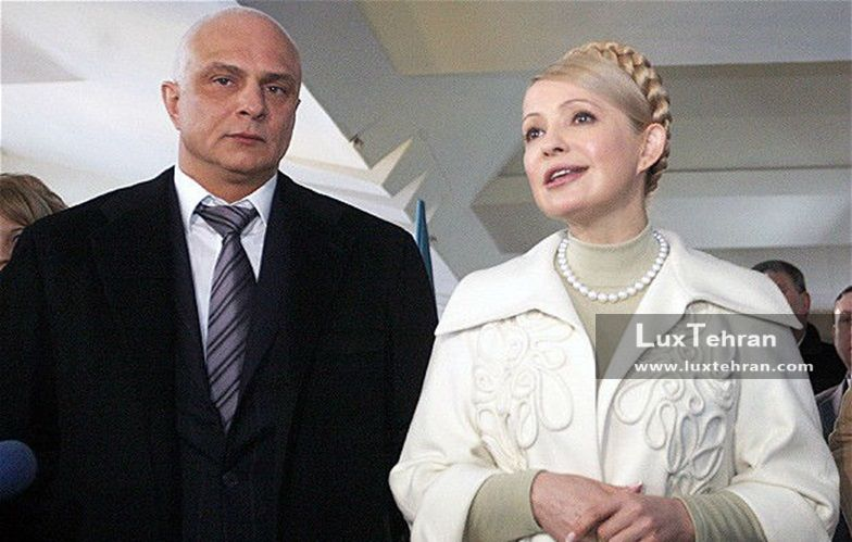تصویر یولیا تیموشنکوف و با استایل سفید رنگ و گردن بند مروارید در کنار همسرش زنان سیاستمدار جهان