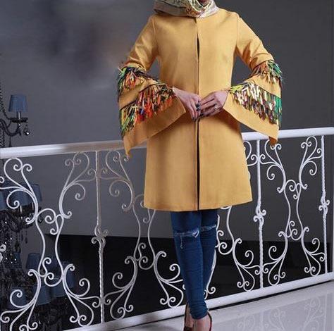 مدل مانتو تابستانی نخی زرد رنگ با آستین مدلدار ست شده با شلوار جین